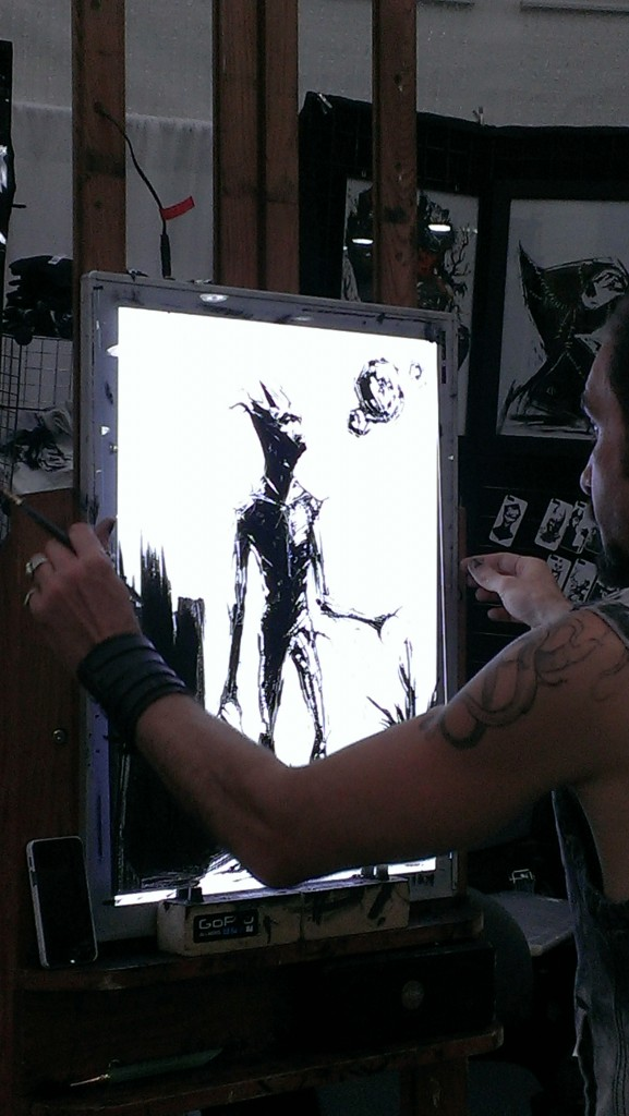 This guy was painting Groot on glass, via a lightbox.